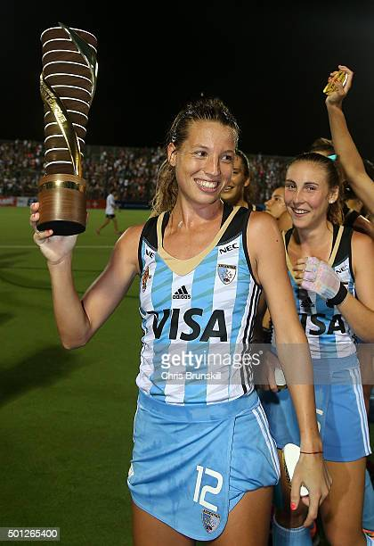 Delfina Merino of Argentina celebrates with the trophy at the end of the final match between Argentina and New Zealand on day 9 of the Hockey World...