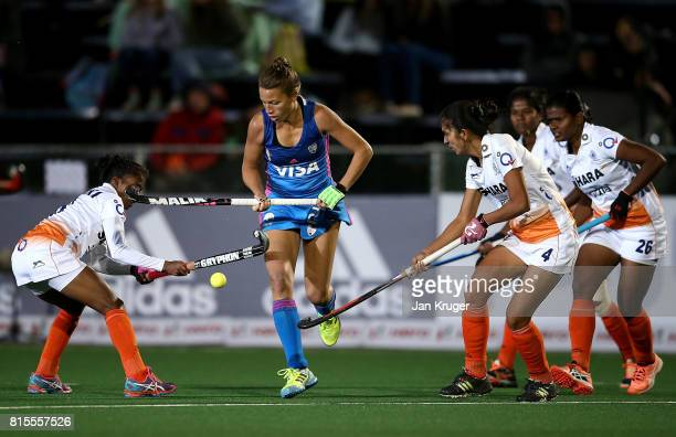 Delfina Merino of Argentina controls the ball from Nikki Pradhan and Monika of India during day 5 of the FIH Hockey World League Women's Semi Finals...