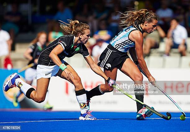 Delfina Merino of Argentina is tackled by Anne Schroder of Germany during the match between Germany and Argentina at Polideportivo Virgen del Carmen...