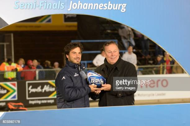 Delfina Merino of Argentina receives the trophy from President of the South African Hockey Association Mike Du Plessis during day 9 of the FIH Hockey...