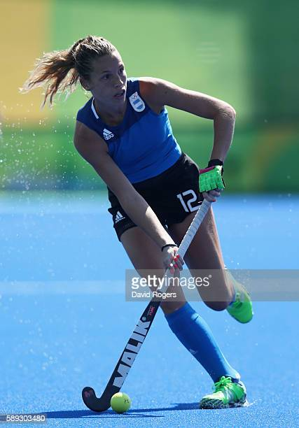 Delfina Merino of Argentina runs with the ball during the Women's pool B hockey match between Argentina and India on Day 8 of the Rio 2016 Olympic...