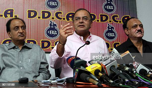 Delhi and District Cricket Association President Arun Jaitley speaks to the media as other DDCA members look on at a press conference in New Delhi on...