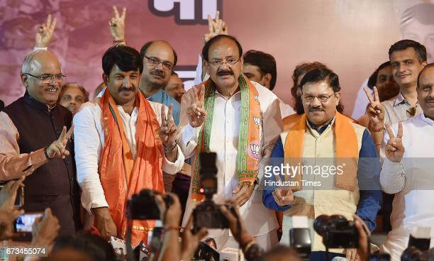 Delhi BJP President Manoj Tiwari along with Venkaiah Naidu showing sign of victory during a press conference at Delhi BJP Office after party's...
