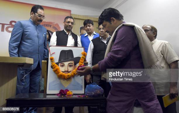 Delhi BJP President Manoj Tiwari and other BJP leaders pay flower tribute to Shaheed Bhagat Singh portrait on the occasion of Shaheedi Diwas at Delhi...
