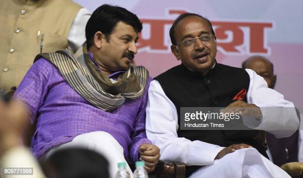 Delhi BJP President Manoj Tiwari talking with Union Minister of sports Vijay Goel during the GSTDelhi Sambodhan organized by the Delhi BJP Thousands...