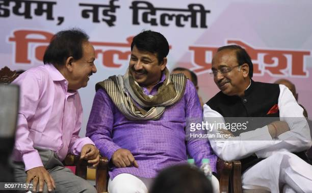 Delhi BJP President Manoj Tiwari talking with Union Minister of sports Vijay Goel and Union minister Harshvadhan during the GSTDelhi Sambodhan...