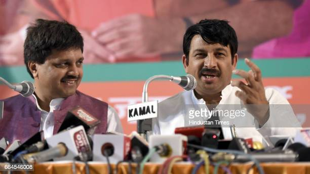 Delhi BJP President Manoj Tiwari with other leader Rajeev Babbar addresses media persons on the issue of Delhi MCD election at Delhi BJP Office on...