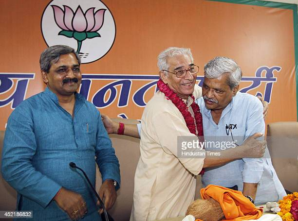 Delhi BJP president Satish Upadhyay and vice president Prabhat Jha with veteran BJP leader OP Kohli during a function to felicitate him on being...