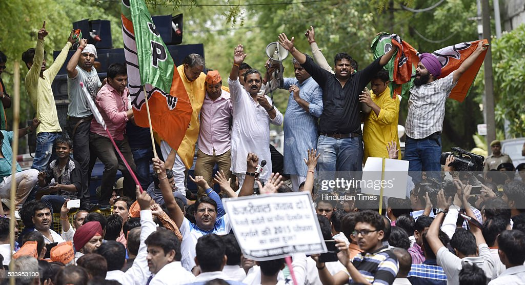 Delhi BJP president Satish Upadhyay leads party workers during a protest over water scarcity and power cuts, outside the residence of Delhi Chief Minister Arvind Kejriwal on May 24, 2016 in New Delhi, India.