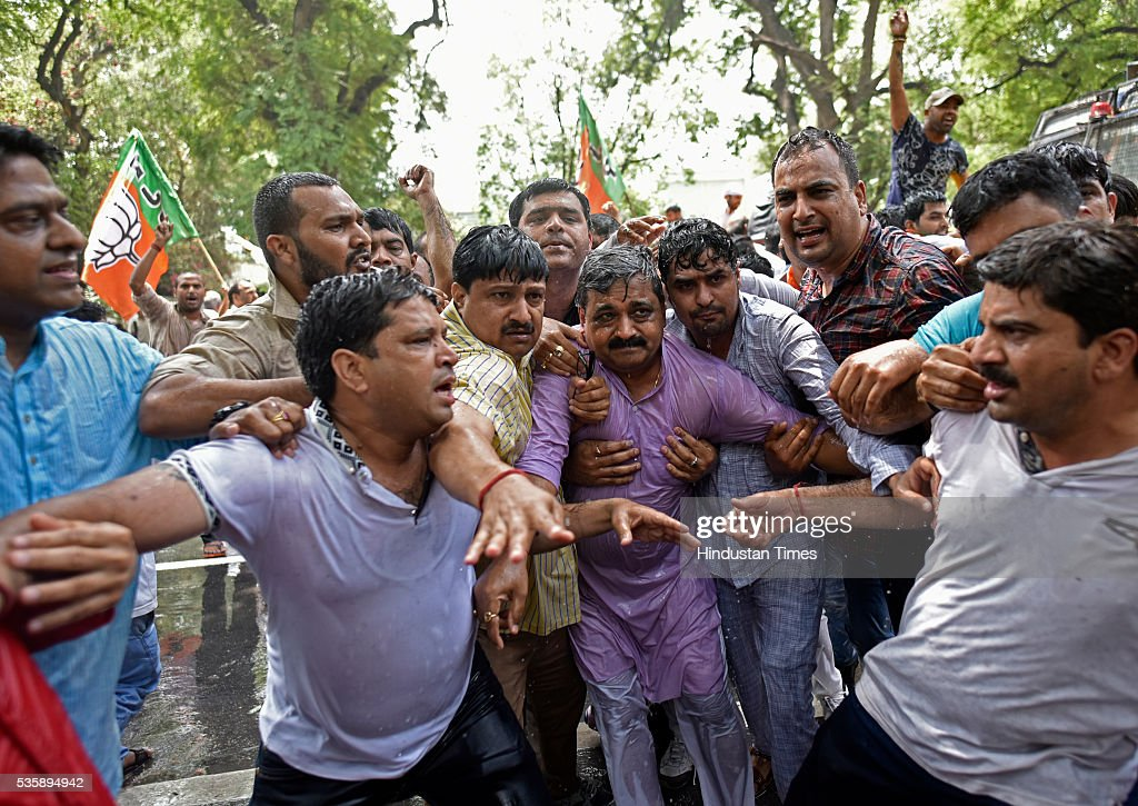 Delhi BJP President Satish Upadhyay with party workers during the protest demanding an apology from Sonia Gandhi and her party leaders on their statements over the Batla House encounter issue at Congress Headquarter on May 30, 2016 in New Delhi, India. BJP has latched onto an IS video where one of the men claimed that he was at Batla House when police had raided the premises and fled afterwards. Last week, Congress general secretary Digvijaya Singh had stoked a controversy after he dubbed the 2008 Batla House encounter as fake.