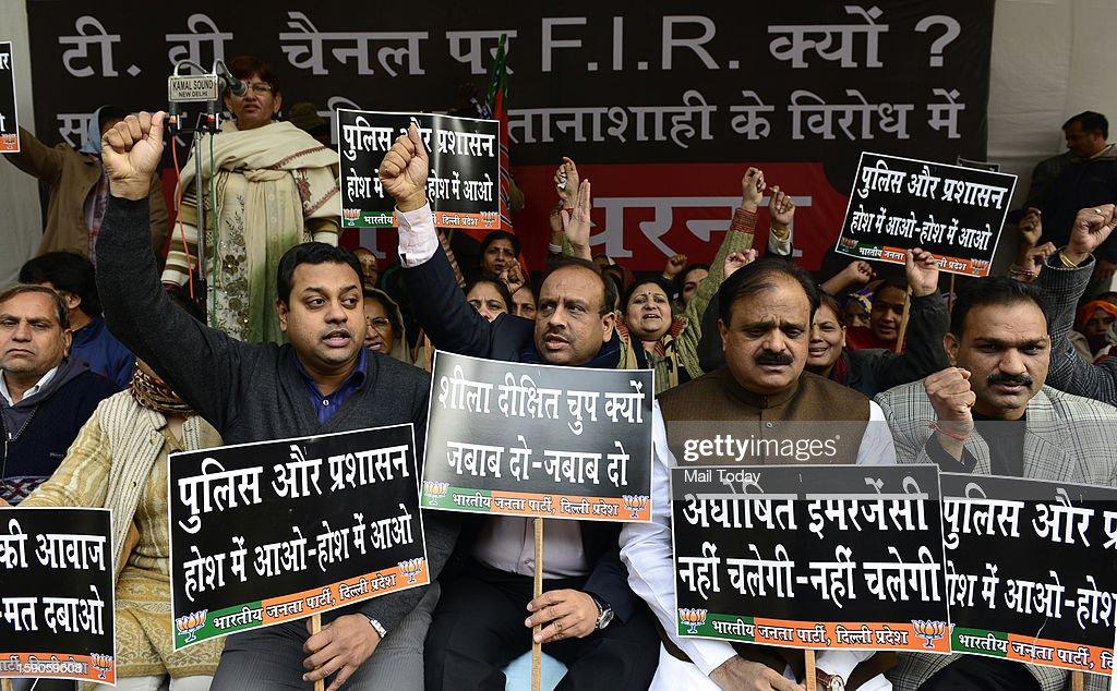 Delhi BJP president Vijender Gupta and others take part in dharna against FIR on media for showing eye witness of gang rape in New Delhi on Sunday.