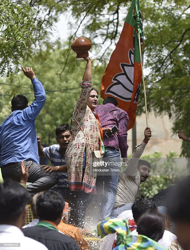 Delhi BJP women workers carry earthen pots during a protest over water scarcity and power cuts, outside the residence of Delhi Chief Minister Arvind Kejriwal on May 24, 2016 in New Delhi, India.