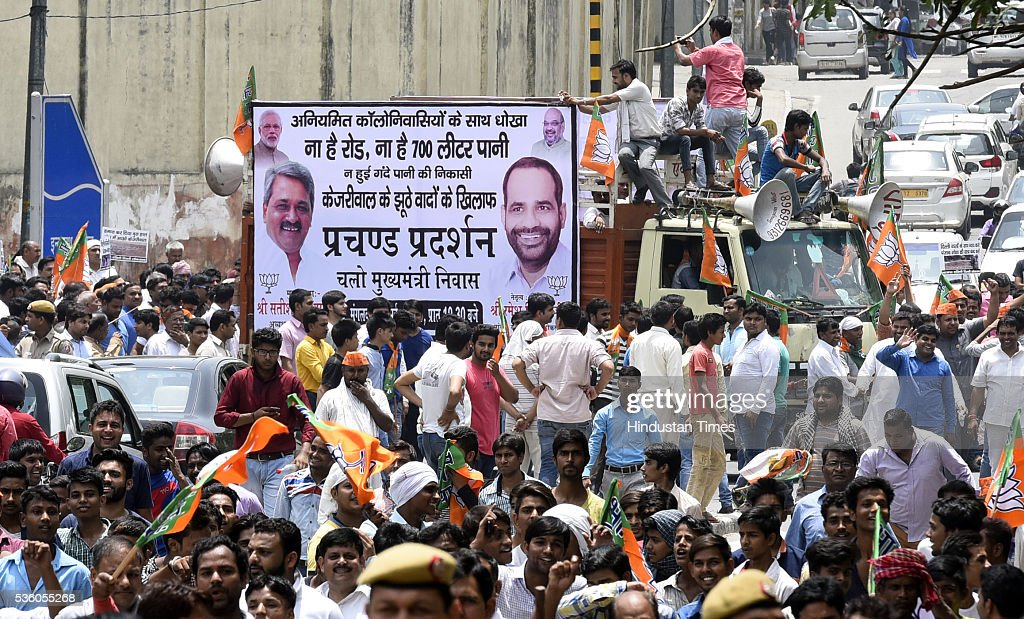 Delhi BJP workers during protest outside the residence of Delhi Chief Minister Arvind Kejriwal demanding improvement in power and water supply on May 31, 2016 in New Delhi, India.