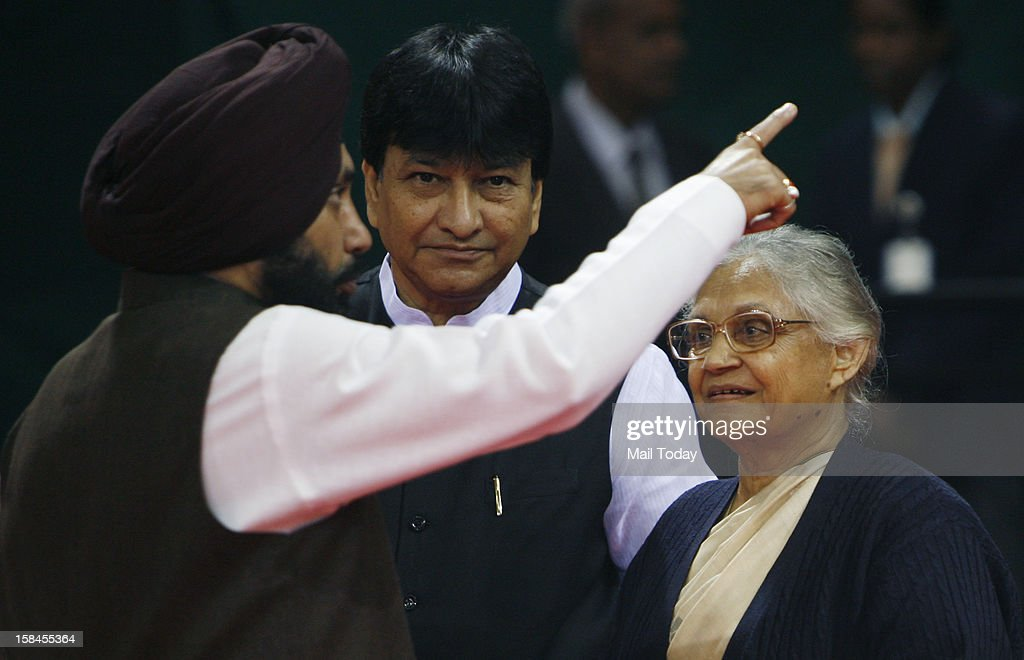 Delhi Cabinet ministers Haroon Yusuf and Arvind Singh Lovely speaks to CM Sheila Dikshit during the launch of Dilli Annashree Yojana in New Delhi on Saturday.