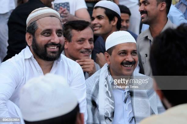 Delhi Chief Minister Arvind Kejriwal along with AAP MLA Amanatullah Khan during an Iftar party at Ansari Auditorium in Jamia Milia University on June...