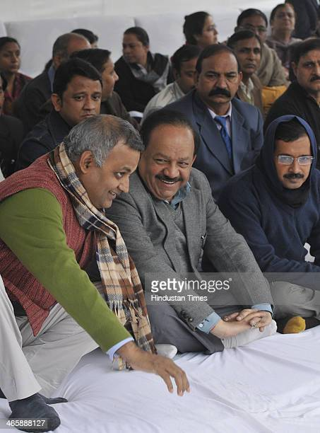 Delhi Chief Minister Arvind Kejriwal and Law Minister Somnath Bharti with BJP leader Harsh Vardhan during an event to pay tributes to the father of...