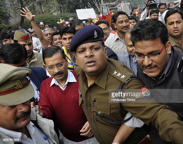Delhi Chief Minister Arvind Kejriwal arrives for 'Janta Darbar' at party's Kaushambi office on February 18 2015 in Ghaziabad India This is first...