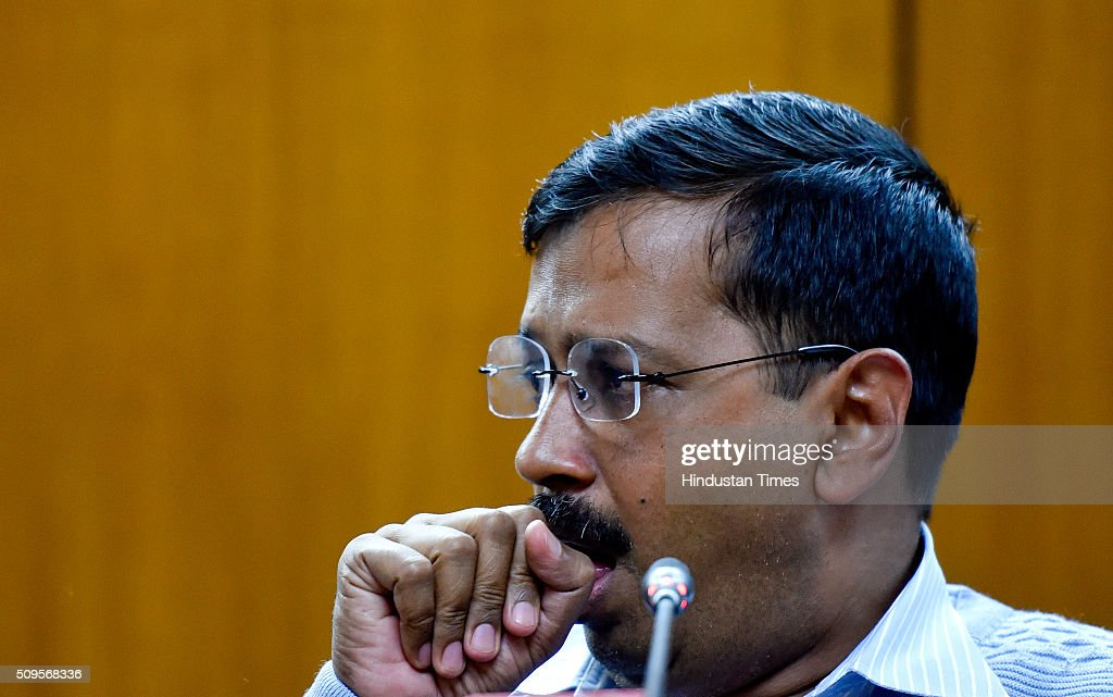 Delhi Chief Minister Arvind Kejriwal coughs during the press conference to announce the commencement date of Second Phase of Odd Even Scheme at Vidhan Shabha on February 11, 2016 in New Delhi, India. The second phase of the odd-even road rationing scheme to reduce the Capitals notorious air pollution and traffic snarls will be conducted for a fortnight from April 15.