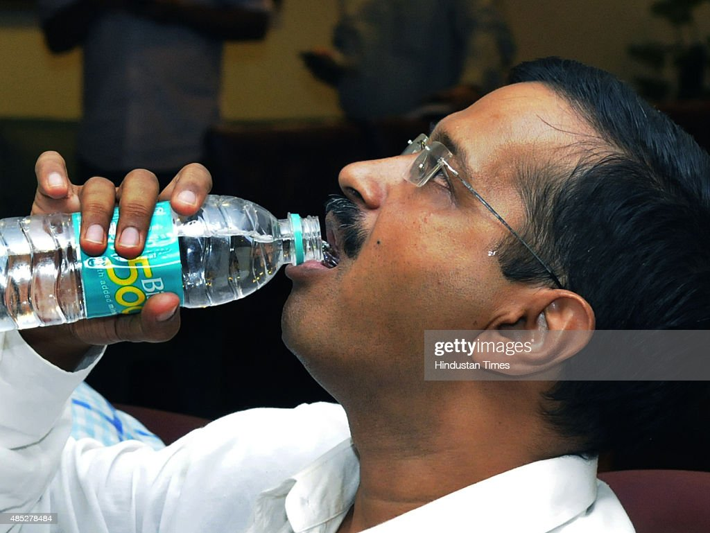Delhi Chief Minister <a gi-track='captionPersonalityLinkClicked' href=/galleries/search?phrase=Arvind+Kejriwal&family=editorial&specificpeople=5980396 ng-click='$event.stopPropagation()'>Arvind Kejriwal</a> drinks water before his meeting with Urban Development Minister M. Venkaiah Naidu and Minister for Water Resources, River Development and Ganga Rejuvenation, Uma Bharti, over specifics of Yamuna rejuvenation plan at Nirman Bhawan, on August 26, 2015 in New Delhi, India. Central and Delhi government would join hands to make the polluted river into a hub of tourism and navigation, and provide clean drinking to the residents.