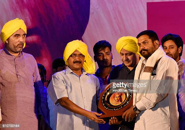 Delhi Chief Minister Arvind Kejriwal felicitates the families of freedom fighters on 110th birth anniversary of Saheed Bhagat Singh observed as...