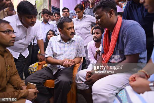 Delhi Chief Minister Arvind Kejriwal meets sanitation workers family at Khichripur on August 8 2017 in New Delhi India Arvind Kejriwal announced...
