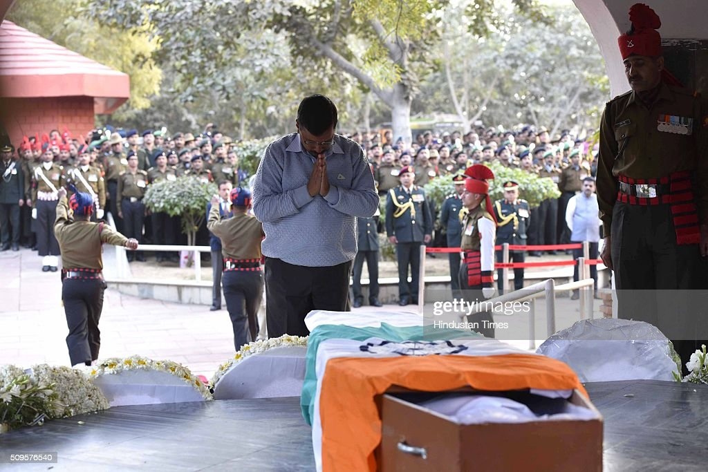 Delhi Chief Minister Arvind Kejriwal paying his last respect to the rescued soldier Lance Naik Hanumanthappa during his funeral ceremony at Brar square crematorium on February 11, 2016 in New Delhi, India. Lance Naik Hanamanthappa Koppad of 19 Madras Regiment was rescued alive on night after being buried under 35 feet of snow for six days. The lone survivor of the February 3 Siachen avalanche that claimed the lives of nine soldiers, breathed his last at the Army RR Hospital in Delhi.