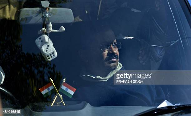 Delhi Chief Minister Arvind Kejriwal sits inside his car as Delhi Police prevent him from reaching the Home Ministry in New Delhi on January 20 2014...