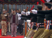 Delhi Chief Minister Arvind Kejriwal takes the salute while inspecting the parade during the state level Republic Day function at Chhatrasal Stadium...