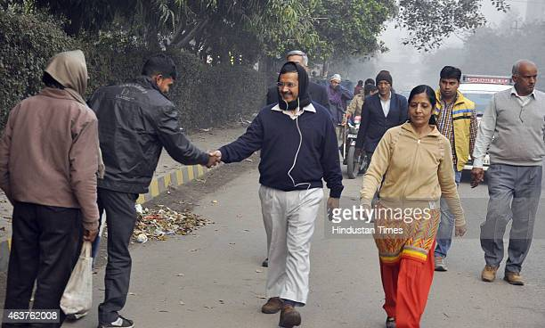 Delhi Chief Minister Arvind Kejriwal taking a morning walk with his wife Sunita Kejriwal at Kaushambi on February 18 2015 in Ghaziabad India