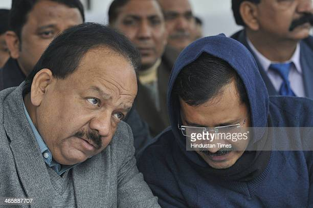 Delhi Chief Minister Arvind Kejriwal talking with BJP leader Harsh Vardhan during an event to pay tributes to the father of the nation Mahatma Gandhi...