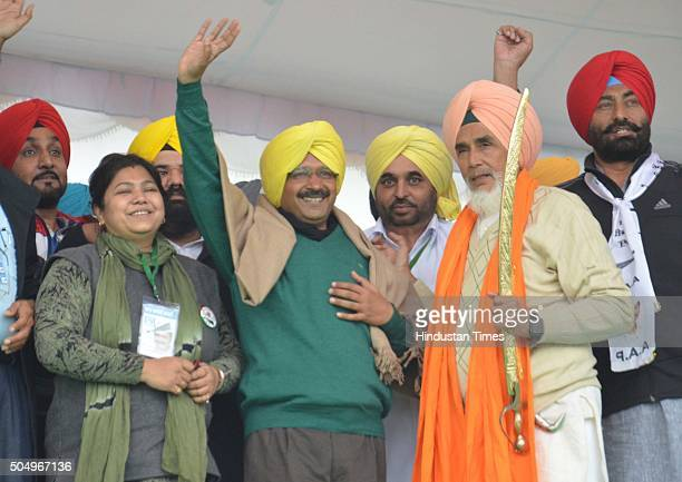 Delhi Chief Minister Arvind Kejriwal wearing a turban offered by party leaders during a public rally on the occasion of Maghi Mela at Muktsar on...