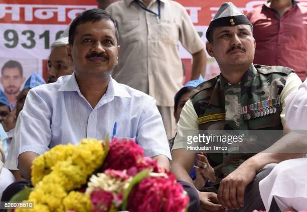 Delhi Chief Minister Arvind Kejriwal with AAP MLA Commando Surinder Singh during a Kirayedar Swabhimaan Bacho Mahasabha to press their various...