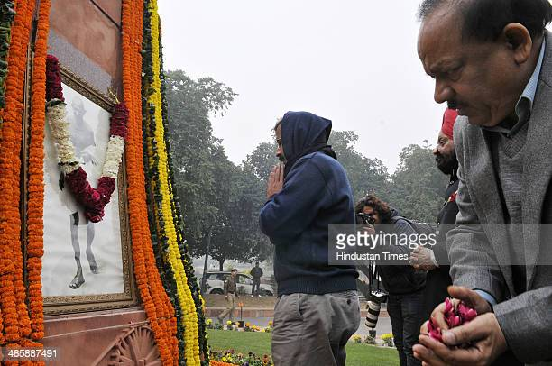Delhi Chief Minister Arvind Kejriwal with BJP leader Harsh Vardhan paying floral tribute to the father of the nation Mahatma Gandhi on his death...