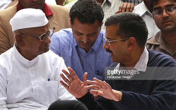 Delhi Chief Minister Arvind Kejriwal with Indian anticorruption activist Anna Hazare during a protest on February 24 2015 in New Delhi India Indian...