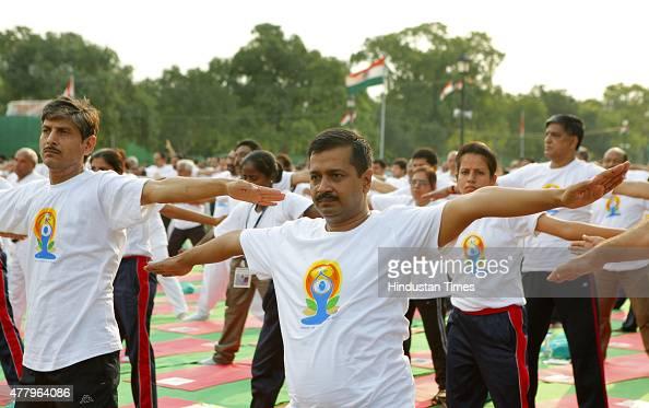 Delhi Chief Minister of Arvind Kejriwal and Deputy Chief Minister Manish Sisodia participate in a mass yoga performance led by Prime Minister...