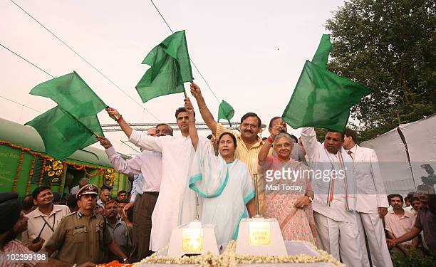 Delhi Chief Minister Sheila Dikshit along with Railways Minster Mamata Banerjee MoS for Railways K H Muniyappa and MoS for IT and Communications...