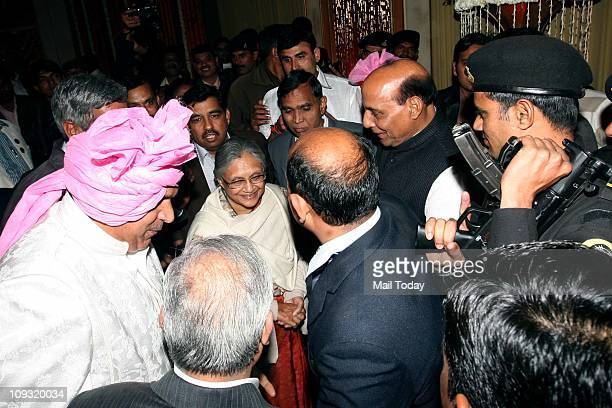 Delhi Chief Minister Sheila Dikshit and BJP leader Rajnath Singh arrive to attend the wedding of Wrestler Sushil Kumar on Friday night