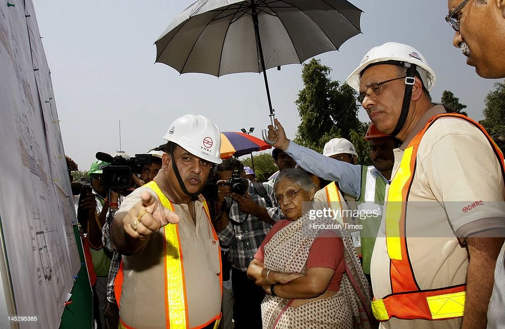 Delhi chief minister Sheila Dikshit (C) and DMRC Managing Director Mangu Singh (R) visit the Mandi House metro site on May 25, 2012 in New Delhi, India. The 9.37 km Central Secretariat-Kashmere Gate corridor, part of Delhi Metro's Phase III, will add a total of seven stations and is expected to ease traffic in congested areas like ITO, Janpath, Kashmere Gate and Daryaganj, among others.