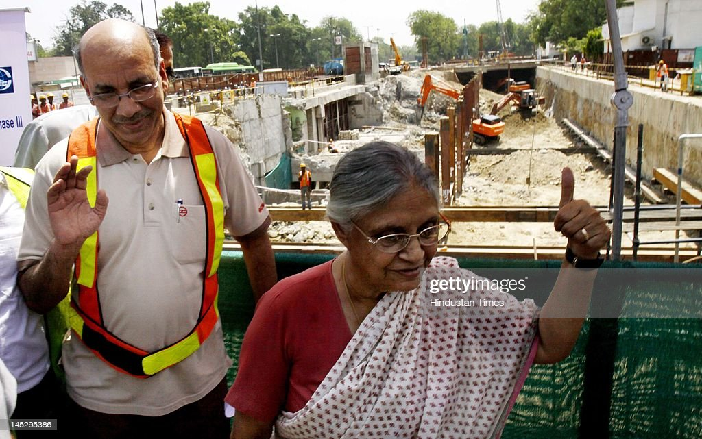 Delhi chief minister <a gi-track='captionPersonalityLinkClicked' href=/galleries/search?phrase=Sheila+Dikshit&family=editorial&specificpeople=728110 ng-click='$event.stopPropagation()'>Sheila Dikshit</a> and DMRC Managing Director Mangu Singh (L) visit the Mandi House metro site on May 25, 2012 in New Delhi, India. The 9.37 km Central Secretariat-Kashmere Gate corridor, part of Delhi Metro's Phase III, will add a total of seven stations and is expected to ease traffic in congested areas like ITO, Janpath, Kashmere Gate and Daryaganj, among others.