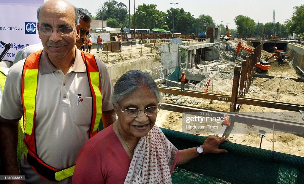 Delhi chief minister Sheila Dikshit and DMRC Managing Director Mangu Singh (L) visit the Mandi House metro site on May 25, 2012 in New Delhi, India. The 9.37 km Central Secretariat-Kashmere Gate corridor, part of Delhi Metro's Phase III, will add a total of seven stations and is expected to ease traffic in congested areas like ITO, Janpath, Kashmere Gate and Daryaganj, among others.