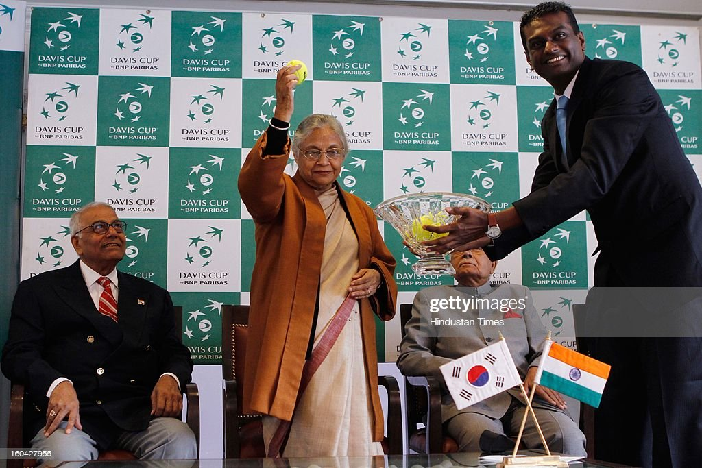 Delhi Chief Minister Sheila Dikshit during the draw for Davis Cup Asia/Oceania Group I at Delhi Lawn Tennis Association (DLTA) tennis court on January 31, 2013 in New Delhi, India. India will host South Korea in the tie scheduled from February 1-3, 2013. All India Tennis Association (AITA) President Yashwant Sinha is seen.