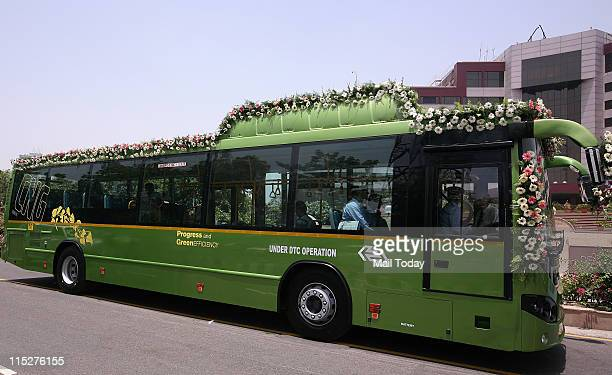 Delhi Chief Minister Sheila Dikshit flag off first CNG city volvo bus in New Delhi on Friday