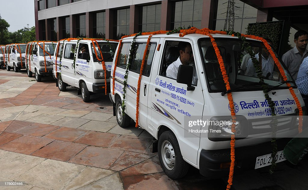 Delhi Chief Minister Sheila Dikshit flags off five mobile vans for women in distress provided by Delhi commission of women at Delhi Secretariat Plaza on July 29, 2013 in New Delhi, India. The decision to operate the service was taken following the December 16 gangrape.