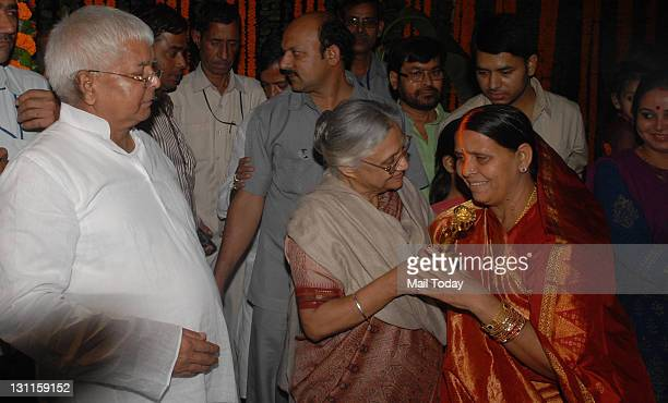 Delhi Chief Minister Sheila Dikshit greets Rabri Devi on the occasion of Chhath puja at Lalu's official residence in New Delhi as RJD Chief Lalu...