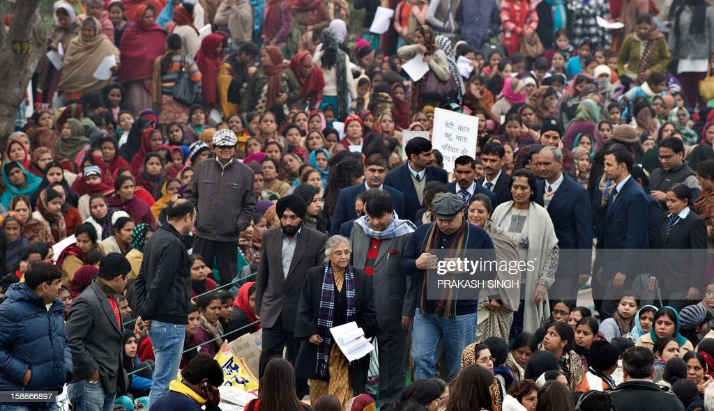 Delhi Chief Minister Sheila Dikshit (foreground C) participates in the Women Dignity march in New Delhi on January 2, 2013. Several hundred people took part in the solidarity march for women organised by the Delhi government which ended at Rajghat, the memorial for slain independence hero Mahatma Gandhi. A gang of rapists who savagely assaulted a woman on a bus in New Delhi tried to run her over after the fatal attack, reports said January 2, citing a police account of the incident. AFP PHOTO/ Prakash SINGH