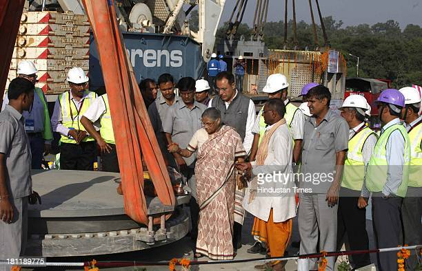 Delhi Chief Minister Sheila Dikshit performs prayers before the commencement of the erection of the central pylon of the Signature Bridge at...