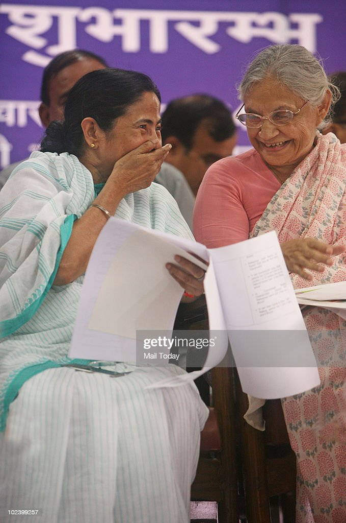Delhi Chief Minister Sheila Dikshit shares a laugh with Railways Minster Mamata Banerjee at the flagging off ceremony of the Commonwealth Express that will make people aware of the Commonwealth Games across the country in New Delhi on June 24, 2010.