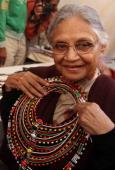 Delhi Chief Minister Sheila Dikshit views beaded jewelry after inaugurating the 25th Annual Dastkari Haat Craft Bazaar at Dilli Haat in New Delhi...