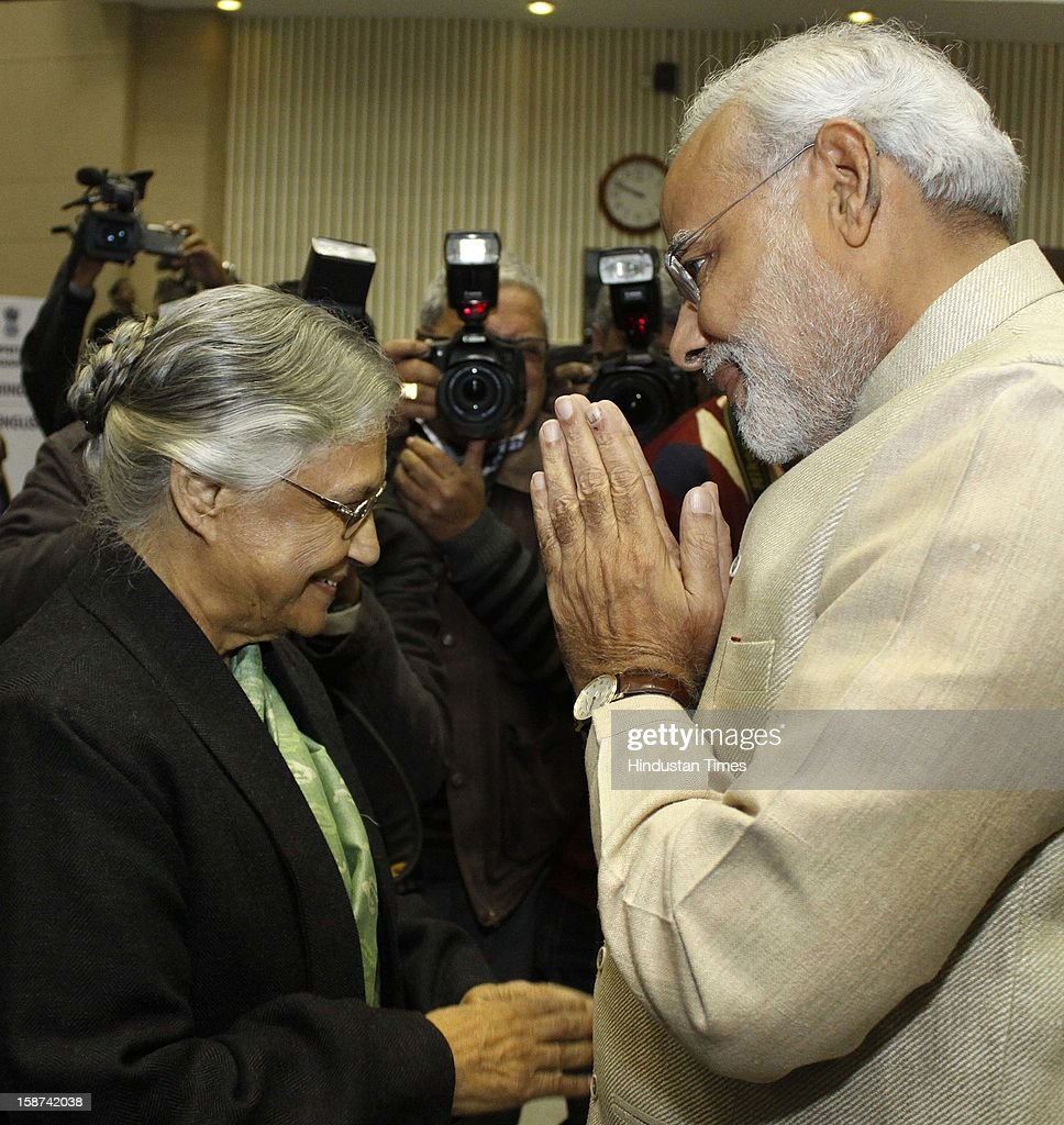 Delhi Chief Minister Sheila Dikshit with Gujarat Chief Minister Narendra Modi at the 57th National Development Council (NDC) meeting on December 27, 2012 in New Delhi, India.