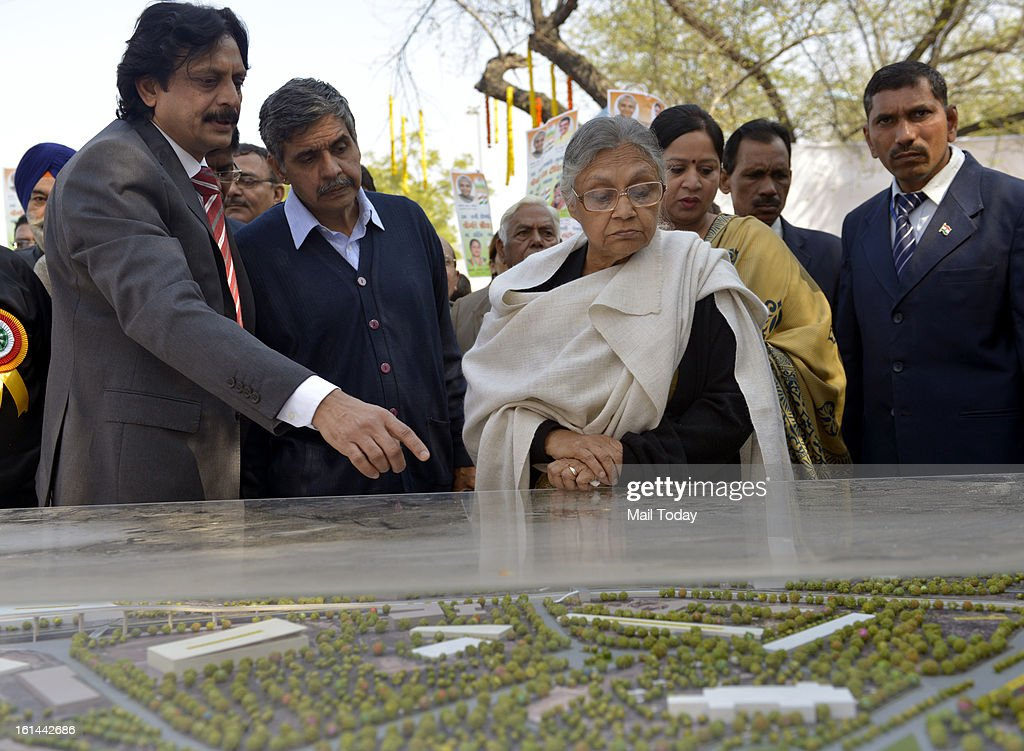 Delhi chief minister Sheila Dikshit with Sandeep Diskhit during inauguartion of Phase II of the Barapullah elevated corridor project in New Delhi.